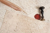 Ancient letters,stamp and feather — Stock Photo