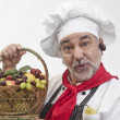 Smiling chef with fresh fruit — Stockfoto