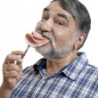Hungry man eating sausage — Stock Photo #33302877