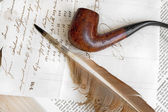 Nineteenth century letter with feather and pipe — Stock Photo