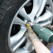 Stock Photo: Removing tire
