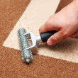 Stock Photo: Installation of carpet