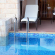 Hotel rooms and swimming pool - Stock Photo