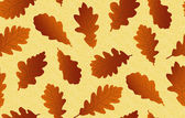 Seamless background with oak leaves — Stock Vector