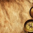 Royalty-Free Stock Photo: Compass on vintage paper