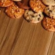 Cookies over wooden background - Photo