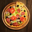 Pizza with ham, pepper and olives — Stock Photo #15552901