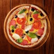 Pizza with ham, pepper and olives — Stock Photo #15552959