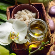 Bowl of salt, oil and orchid with towel — Stock Photo
