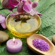 Oil and orchid with green leaf — Stock Photo #15553151