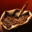 Coffee beans on burlap sack — Stockfoto #15553283