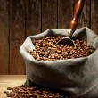 Coffee beans on burlap sack — Stock Photo