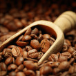 Stock Photo: Coffee beans and wooden scoop