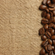 Coffee beans on burlap texture — Foto Stock #15555143