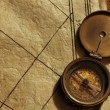 Old compass on vintage background — Photo