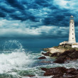 Lighthouse sits on the edge of the Crimean peninsula - Stock Photo