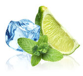 Ice cubes, mint leaves and lime on a white — Stock Photo