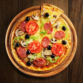 Pizza with ham, pepper and olives — Stock Photo
