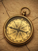 Old compass on vintage background — Stock Photo