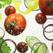 Vegetables and water splashing — Stock Video #22242145
