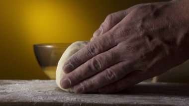 Hands kneading bread dough on a cutting board — Stock Video
