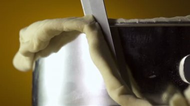Knife cutting excess dough — Stock Video