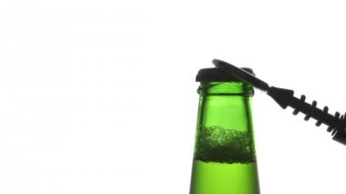 Opening beer bottle with metal opener slow motion — Stock Video