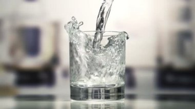 Fresh cool water pouring in a clean glass. — Stock Video