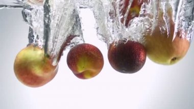 Fresh Fruits being shot as they submerged under water. — Stock Video