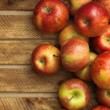 Red apples in wooden box — Stock Photo