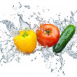 Tomato, cucumber, pepper in spray of water — Stock Photo