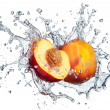 Peach in spray of water. — Stock Photo