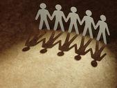 Skupina lidí papíru, drželi se za ruce. — Stock fotografie