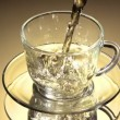 Tea being poured into glass tea cup — Stockvideo