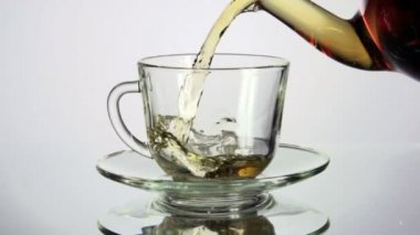 Tea being poured into tea cup — Stock Video