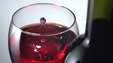 Red wine being dropped into glass — Stock Video