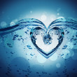 Heart from water splash with bubbles — Stock Photo #36004587