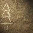 Rock painting of christmas tree — Stock Photo #36004717