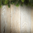 Christmas fir tree on wood texture. background old panels — Stock Photo #37158645