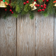 Christmas fir tree on wood texture. background old panels — Stock Photo #37158675