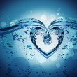 Stock Photo: Heart from water splash with bubbles