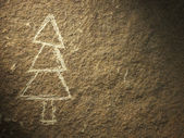 Rock painting of christmas tree — Stock Photo