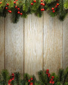 Christmas fir tree on wood texture. background old panels — Stockfoto
