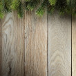 Christmas fir tree on wood texture — Stock Photo #37453297