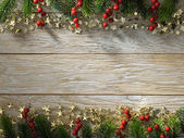 Christmas fir tree on wood texture — Stock Photo