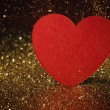 Glitter background with red paper heart — Stock Photo