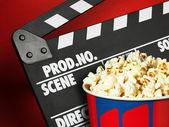 Clapper board and popcorn box — Stock Photo