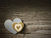 Holiday hearts on wooden background — Stock Photo
