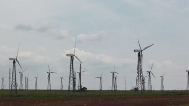 Row of wind power generators — Stock Video