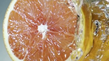 Halved healthy grapefruit in clean fresh pure running water — Stock Video